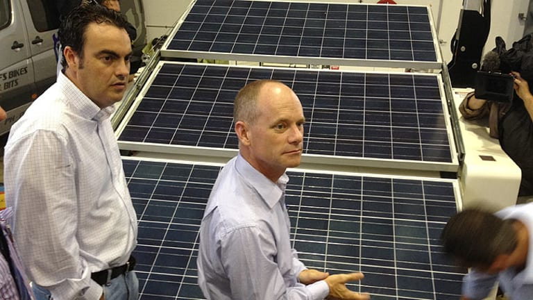 Campbell Newman inspects solar panels in Mackay during the state election campaign.