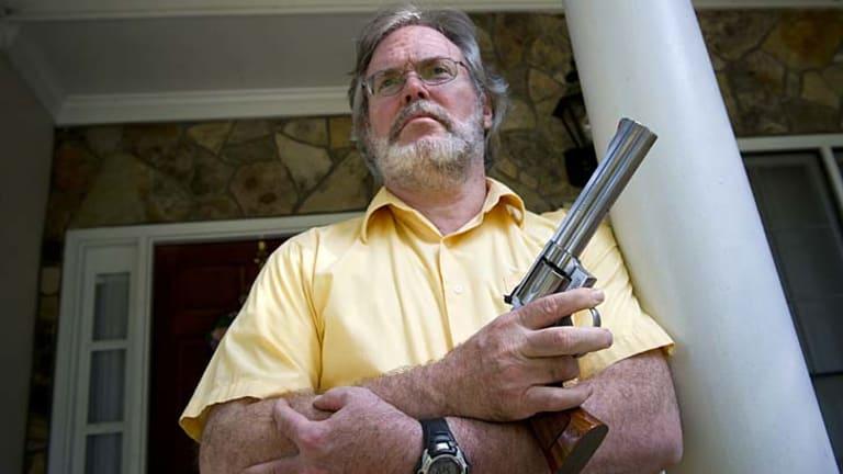 Gun holder ... Kennesaw historian, author and gun advocate Robert Jones.