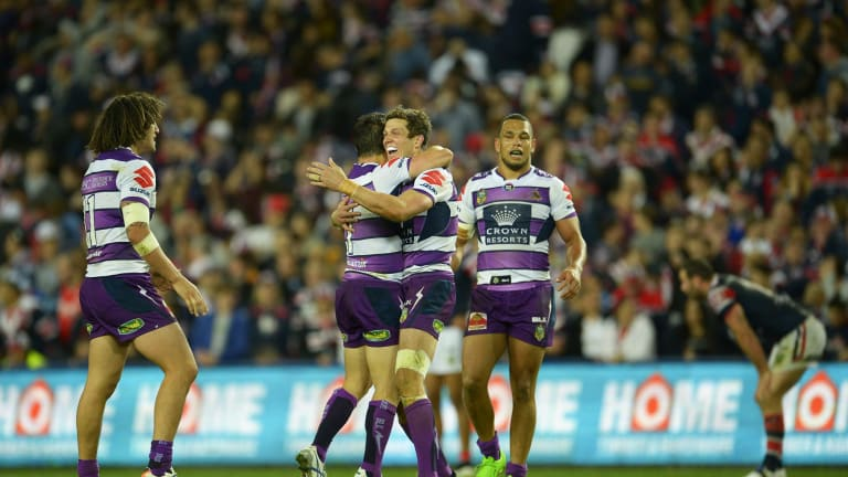 Final fling: Matthew Duffie celebrates victory with Cooper Cronk after the Storm's win over the Roosters.