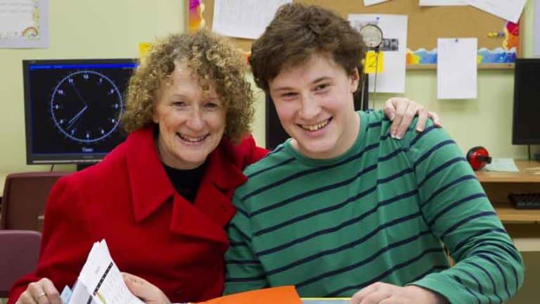 Debra Gilmore with son Robert at an Arrowsmith school in Canada.