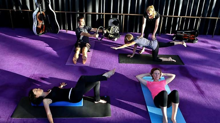 Health and wellbeing training: Instructor Jane Leathwood conducts a pilates class with SSO musicians David Campbell, Rosemary Curtin, Rachel Silver and Elizabeth Neville.