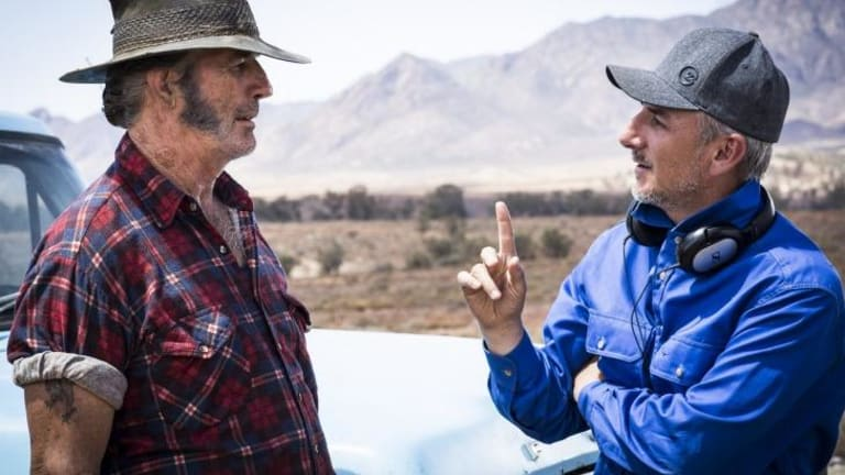 Getting gory again: Director Greg McLean (right) on the set of <i>Wolf Creek 2</i> with John Jarratt.