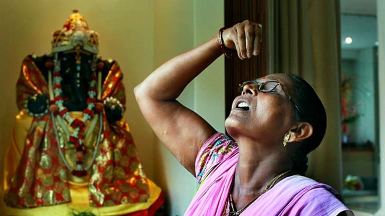 Sacred space . . . Vijay Patel perorms her daily prayers in Australia's first hindu temple. which was attacked by armed men earlier this month.