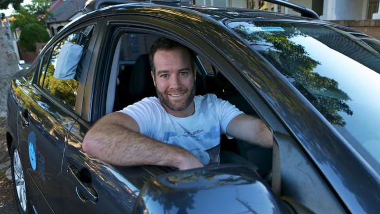 Carl O'Sullivan with his Mazda3 that he rents out to strangers as part of  car-sharing scheme Car Next Door.
