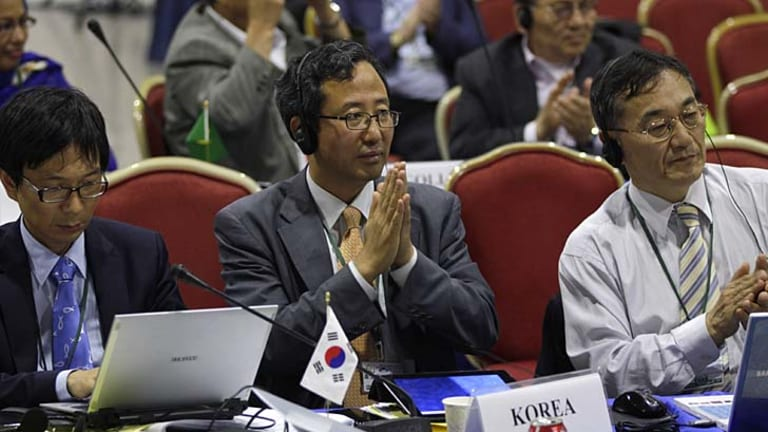 Representatives from South Korea attend a meeting on the last day of the 64th annual International Whaling Commission meeting in Panama City.