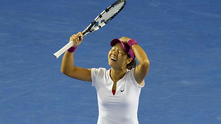 Li Na after completing a straight sets win in the women's final.