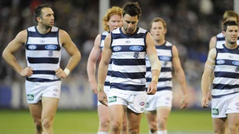 Jimmy Bartel leads Geelong off after the preliminary final defeat against Collingwood.