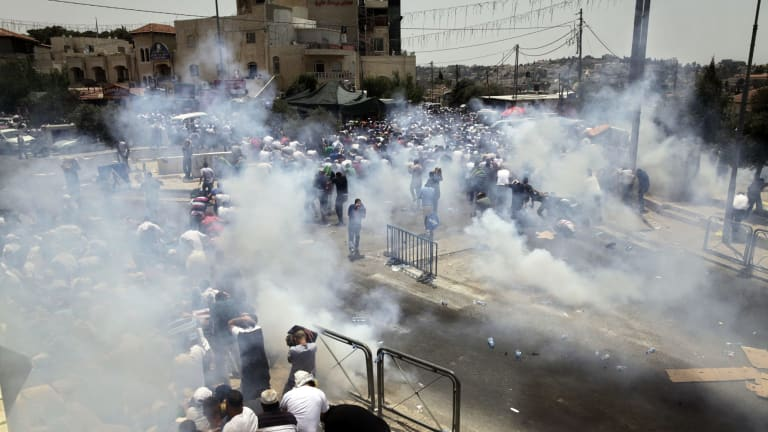Tear gas is used on Palestinian protesters in Jerusalem on Friday.