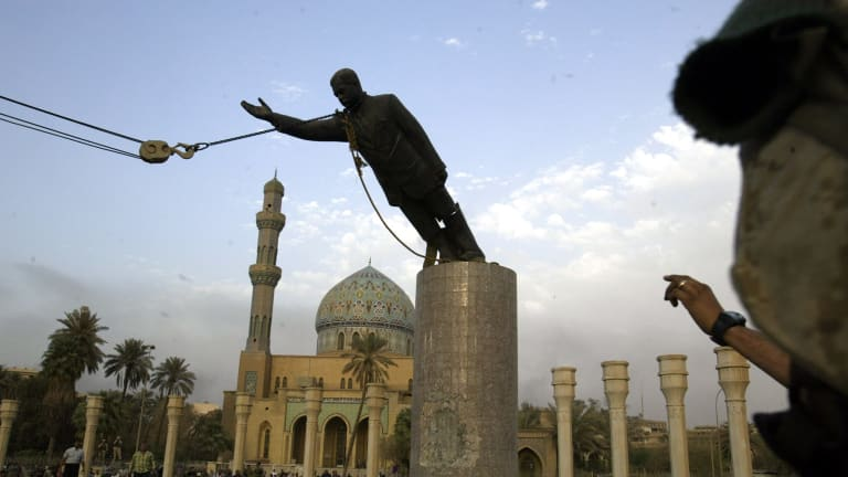 The statue of Saddam Hussein being toppled in Firdaus Square, downtown Bagdhad in 2003. The sledgehammer damage is visible on the base.