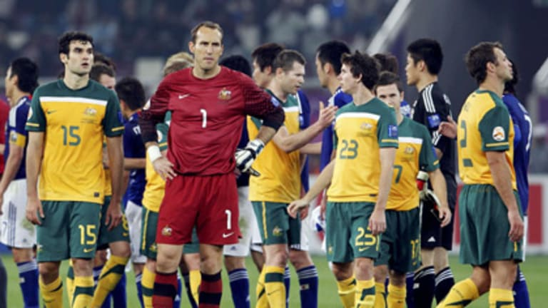 Australia's goalkeeper Mark Schwarzer (number one) and teammates react after losing the 2011 Asian Cup final to Japan.