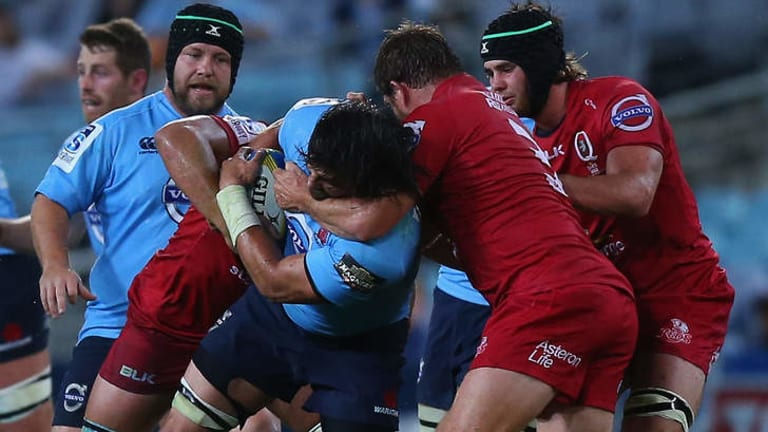 """I just go hard at whatever I do,'' says Waratahs second-rower Jacques Potgieter, pictured mixing it with the Reds last Saturday night."