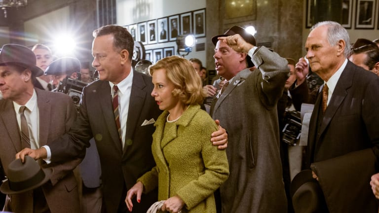 Tom Hanks, Amy Ryan and Alan Alda (far right) in <i>Bridge of Spies</i>.