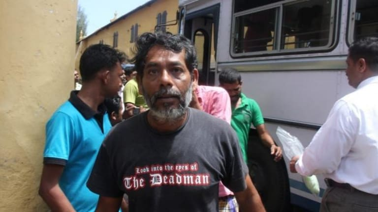 Repatriated to Sri Lanka by the Australian navy ... One of 41 asylum seekers is delivered to court in Galle, Columbo by Sri Lankan navy personnel.