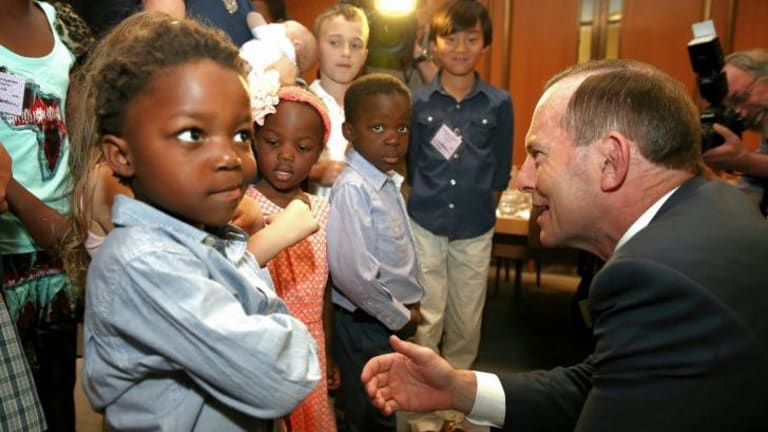 Prime Minister Tony Abbott meets with families.
