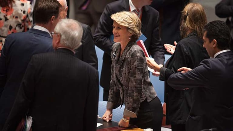 Australian Minister of Foreign Affairs Julie Bishop talks to other attendees before a Security Council meeting on small arms, during the 68th United Nations General Assembly at UN headquarters in New York.