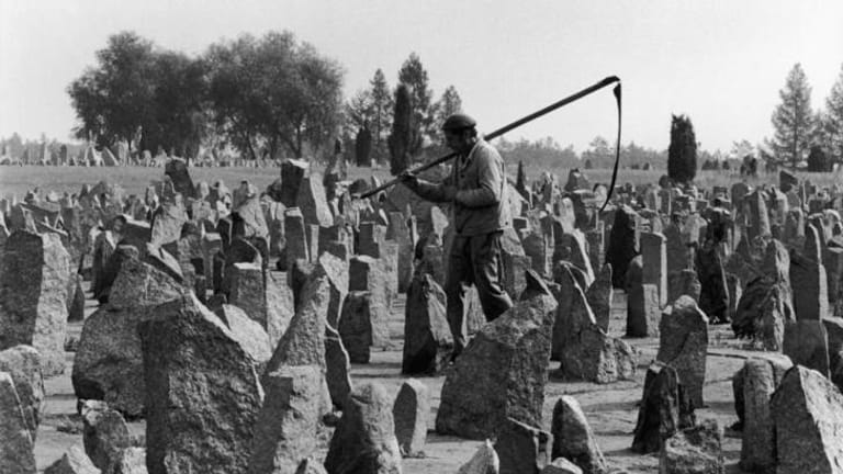Lest we forget: A worker walks among the memorial's 17,000 stones in 1990.
