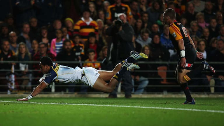 Brumbies centre Christian Lealiifano dives over to score before half-time in the Super Rugby final.