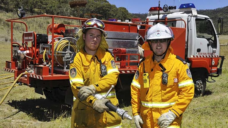 Ready to go to work … Josh Murray and Ash Mansell, both volunteers for the Lithgow Rural Fire Service, in their work gear.