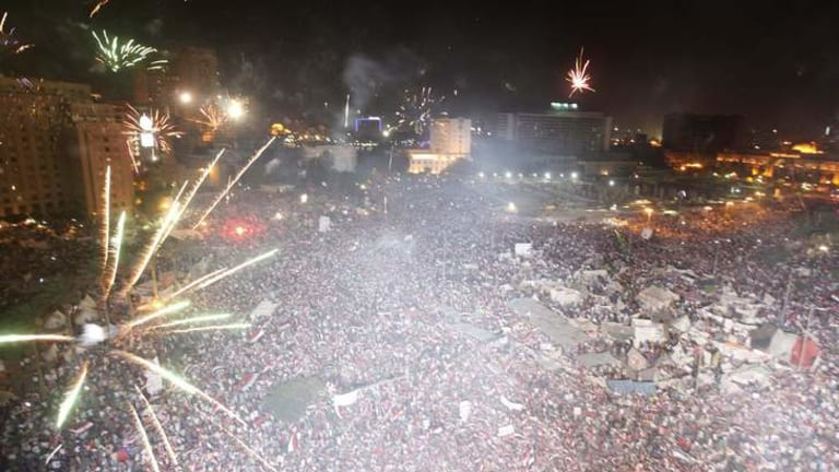Protesters set-off fireworks as they gather in Tahrir Square in Cairo.