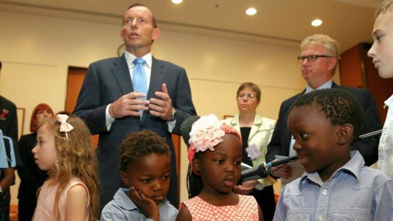 Jemima Dombkins, Charlie Dombkins, Shay Dombkins and Jabari Dombkins listen as Prime Minister Tony Abbott delivers his remarks at a morning tea.
