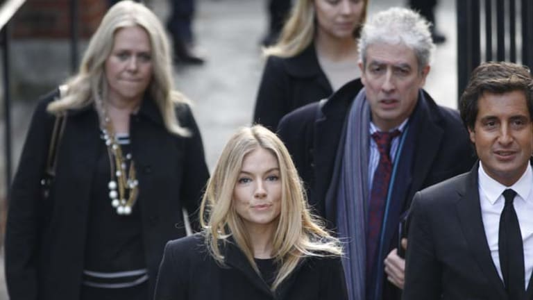 British actress Sienna Miller, center, arrives to testify at the Leveson inquiry at the Royal Courts of Justice in central London.