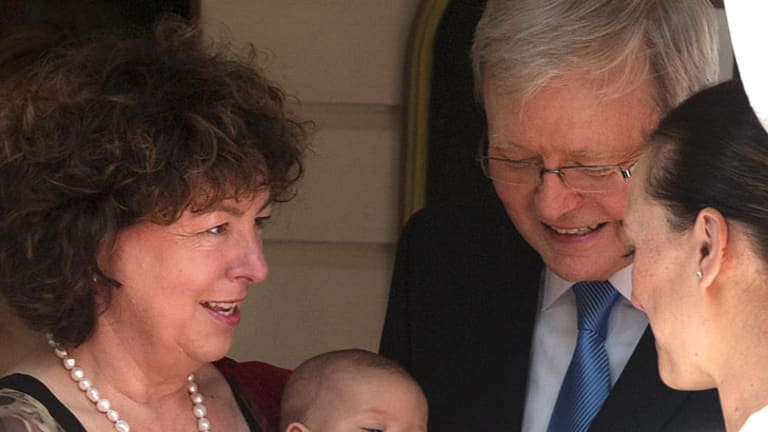Kevin Rudd and Therese Rein play with a baby in the entrance way of st John The Baptist Church in Bulimba, February 26, 2012.