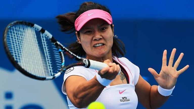 Tough match ... Li Na hits a forehand.