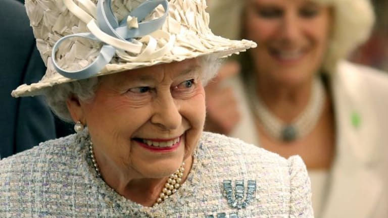"""Keep away from the snacks: Queen Elizabeth II was irritated policemen were """"helping themselves to nuts""""."""