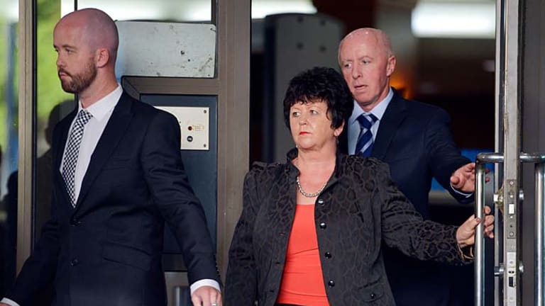 Jill Meagher's brother Michael, mother Edith and father George McKeon outside the court.