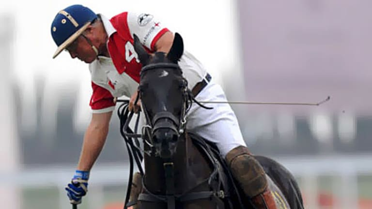 Energetic ... James Ashton takes to the field during one of his many polo matches.
