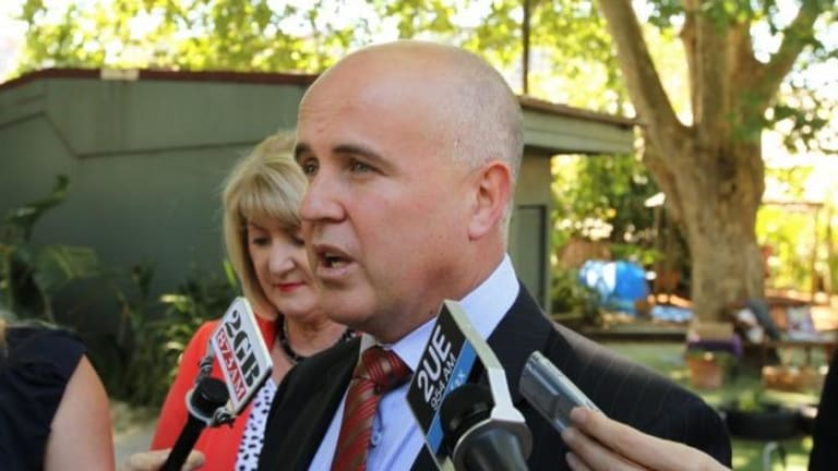 Education Minister Adrian Piccoli pushed for youth workers to be included.