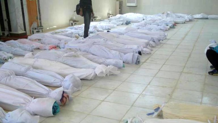 A handout picture released by the Syrian opposition's Shaam News Network shows bodies lying at a hospital morgue after the massacre at the central Syrian town of Houla.