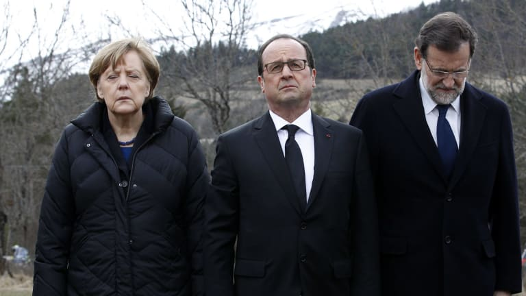 German Chancellor Angela Merkel, left, French President Francois Hollande, centre, and Spanish Prime Minister Mariano Rajoy pay their respects near the mountain where a Germanwings jetliner crashed.