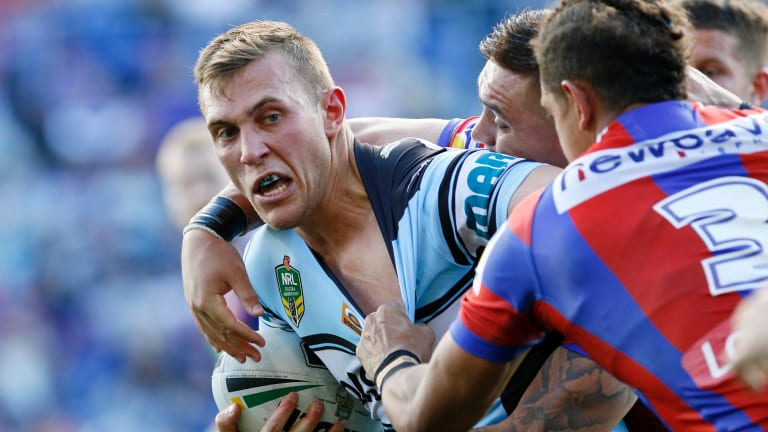 Handful: Cronulla's Kurt Capewell makes inroads on Sunday.