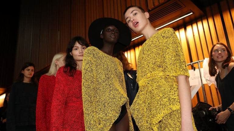 Models pose backstage ahead of the Mercedes-Benz Presents Dion Lee.