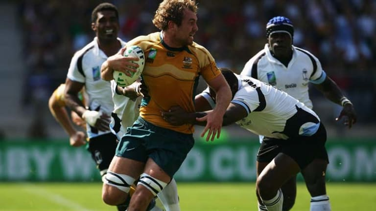 Vereniki Sauturaga of Fiji tackles Rocky Elsom of Australia during the 2007 World Cup.