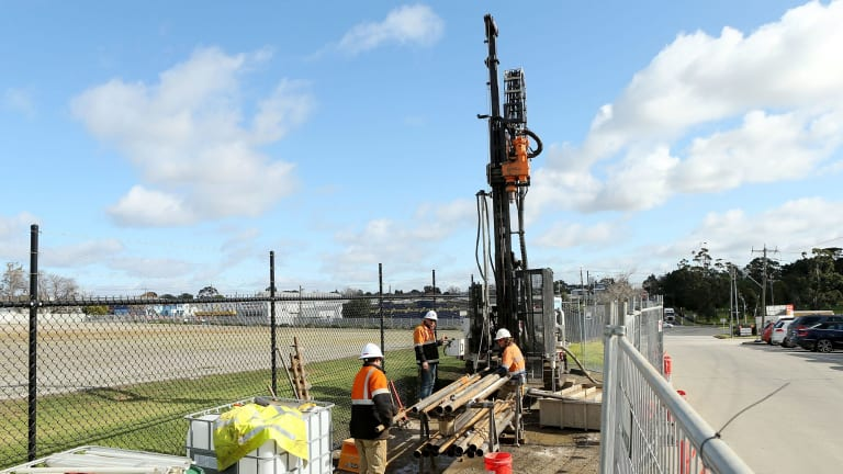 Transurban site investigators are seen drilling on the proposed Western Distributor toll road in Yarraville.
