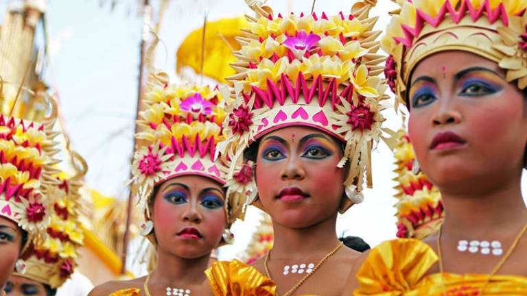 Balinese women get ready to perform at a ceremony for at a Hindu temple.