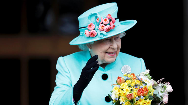 The former owner of a luxury British bra maker that supplied lingerie to Queen Elizabeth says the company lost its royal warrant after she wrote a book disclosing details of fittings at Buckingham Palace.