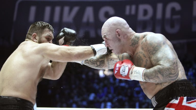 Title win: Lucas Browne, right, zeroes in on Uzbekistan's Ruslan Chagaev.