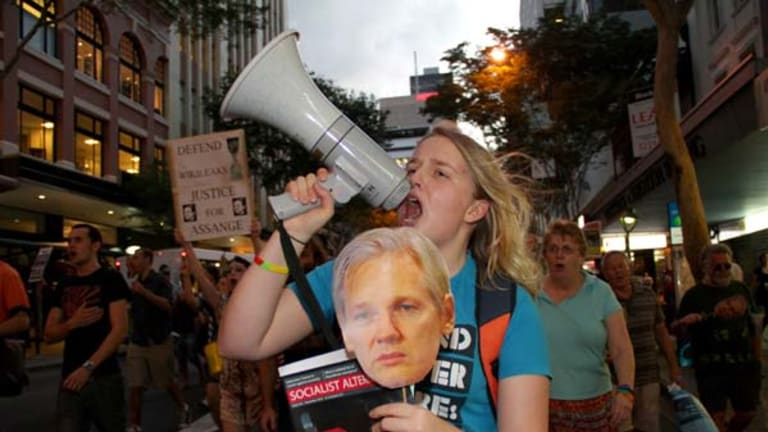 Kat Henderson makes her displeasure known as she joins supporters of Julian Assange, the Wikileaks founder, at a rally in Brisbane.