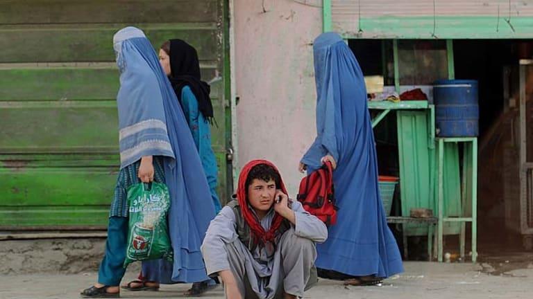 An Afghan man speaks on a phone in Kabul.