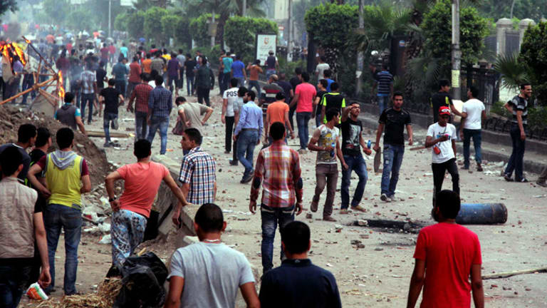 Protesters and Mursi supporters clash outside Cairo University on Wednesday.