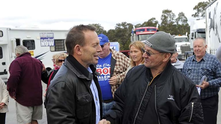 To address truck drivers' rally … the Opposition Leader, Tony Abbott, meets convoy protester Ken Wilkie at Marulan near Canberra yesterday.