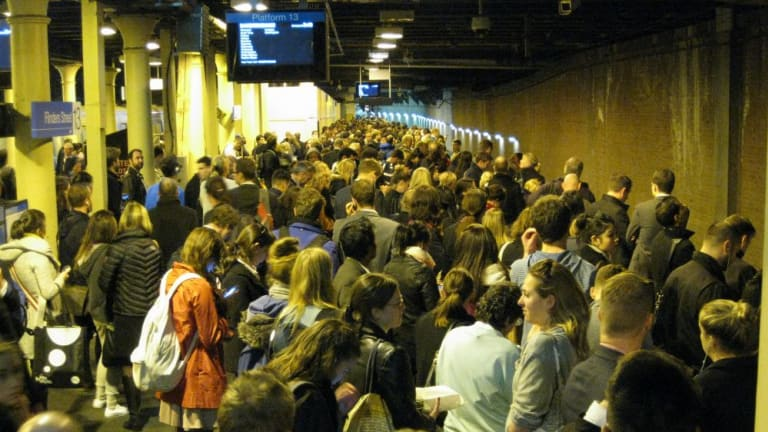 People crowd the platform at Flinders Street station about 6pm Wednesday.