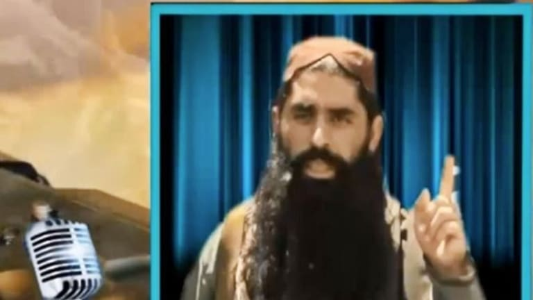 'Your children will not escape': An image taken from a Taliban video showing Umar Mansoor.
