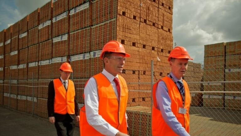 Tony Abbott tours the Sydney plant of Brickworks with its managing director, Liberal donor Lindsay Partridge, in September 2011.