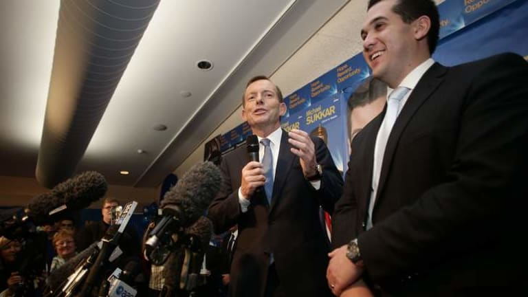 Opposition Leader Tony Abbott addresses the party faithful during a campaign office event in Ringwood, Victoria.
