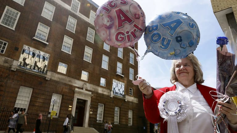 Royal supporter Margaret Tyler displays balloons for the media in front of the Lindo Wing at St Mary's Hospital in London.