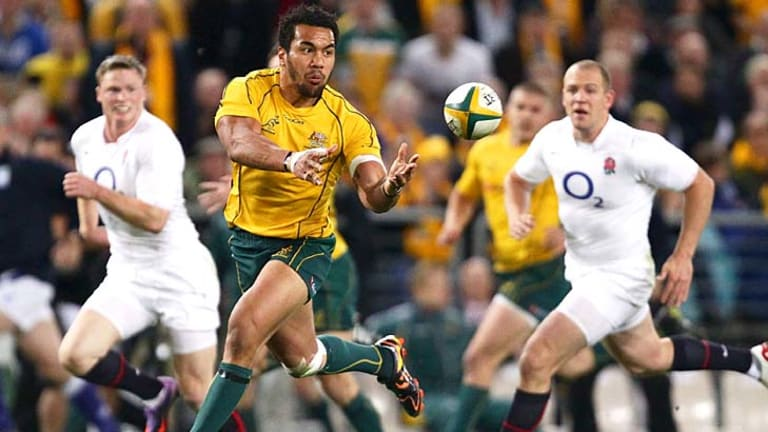 Digby Ioane breaks through into open space for the Wallabies.